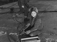 "A ""Wendy the Welder"" at the Kaiser Richmond Shipyards contributing to the war effort."